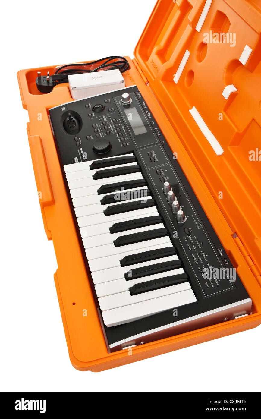 2006 Korg Micro X portable 25-key music synthesizer / controller in orange hard case - Stock Image