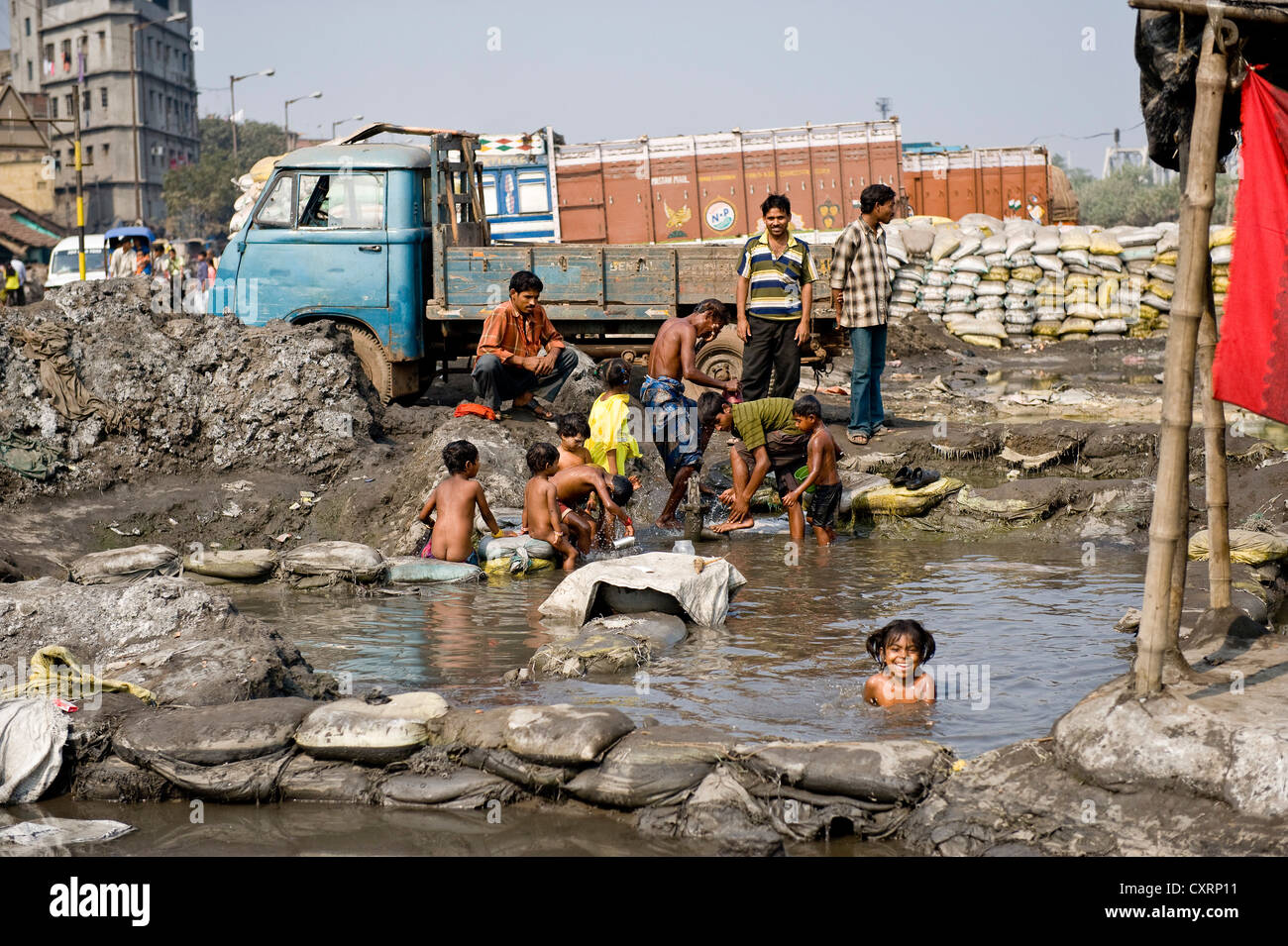 Children swimming and playing in water contaminated with heavy metals, Shibpur district, Haora or Howrah, Calcutta, - Stock Image