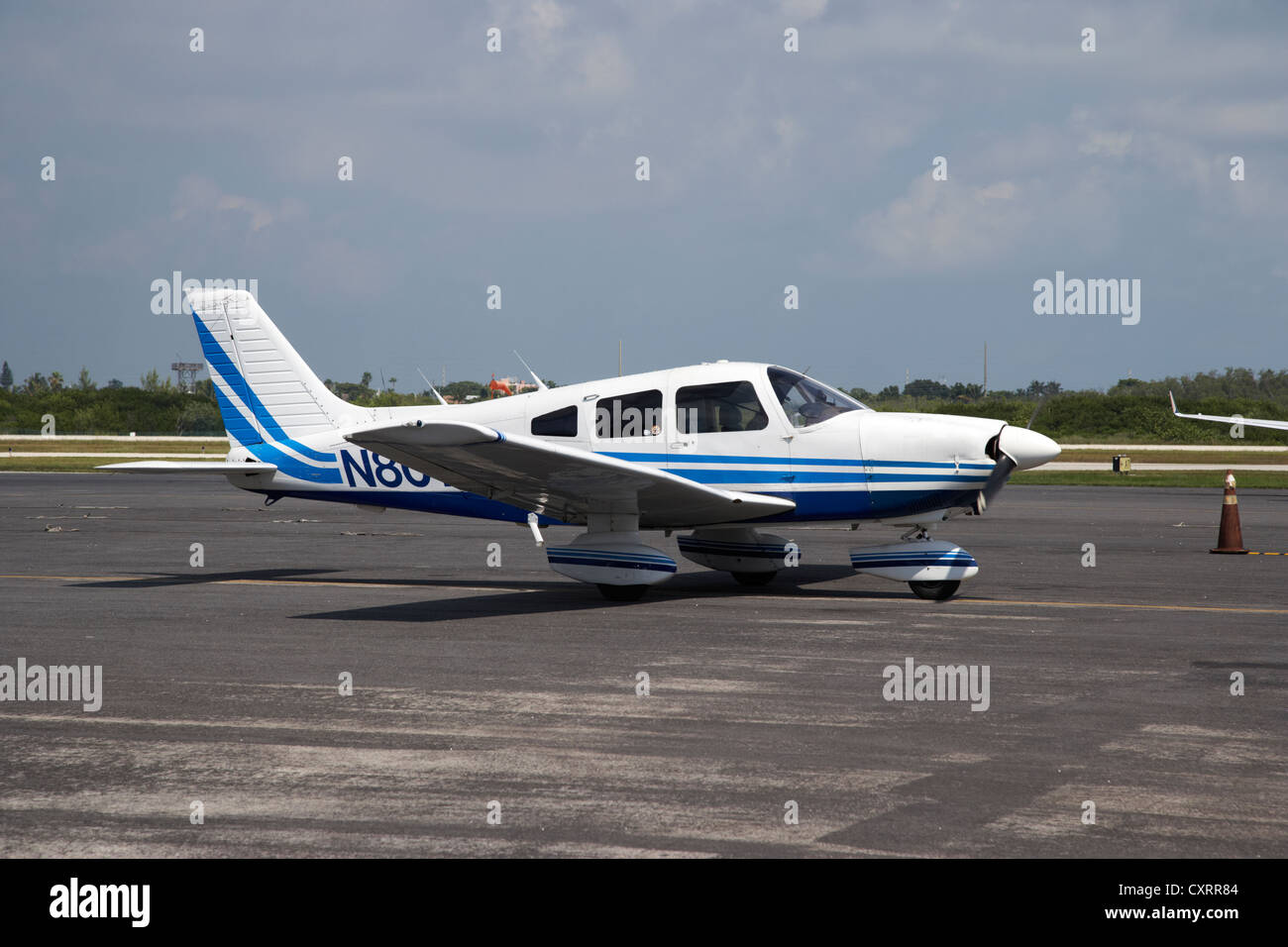 small single engined private aircraft taxis in key west international airport florida keys usa - Stock Image