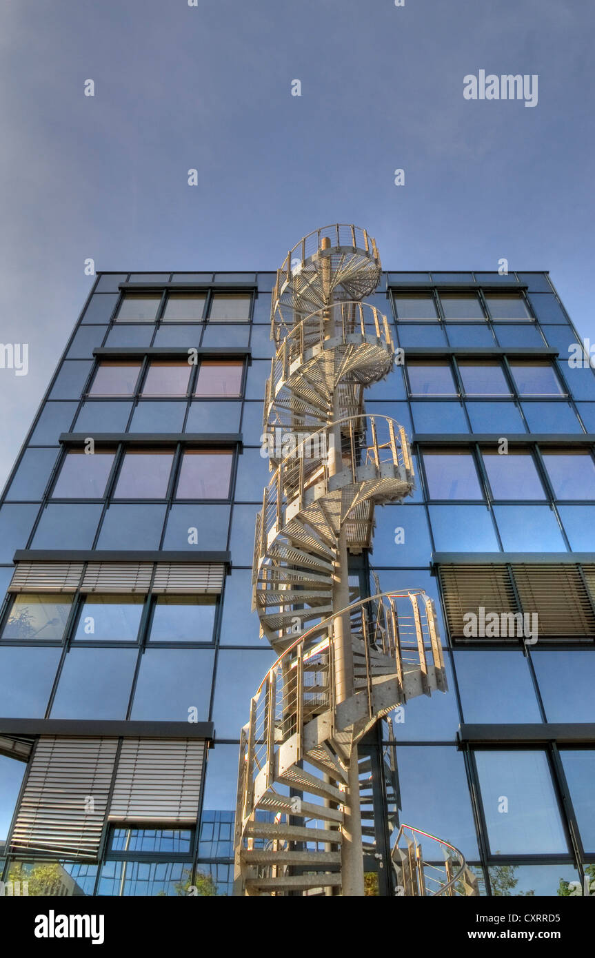 Modern Office Architecture With Spiral Staircase, Glass Office Building,  Metal External Staircase, Blue Sky, Near Munich