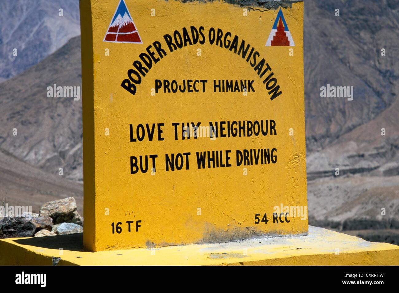 Stone sign, poetic invitation to drive carefully, Nubra Valley, Ladakh, Indian Himalayas, Jammu and Kashmir, North - Stock Image