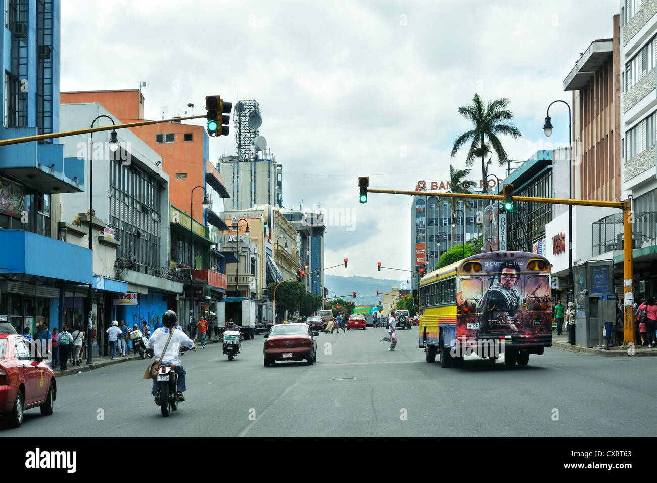 Painted bus and many traffic lights, San Jose, Costa Rica, Central America - Stock Image