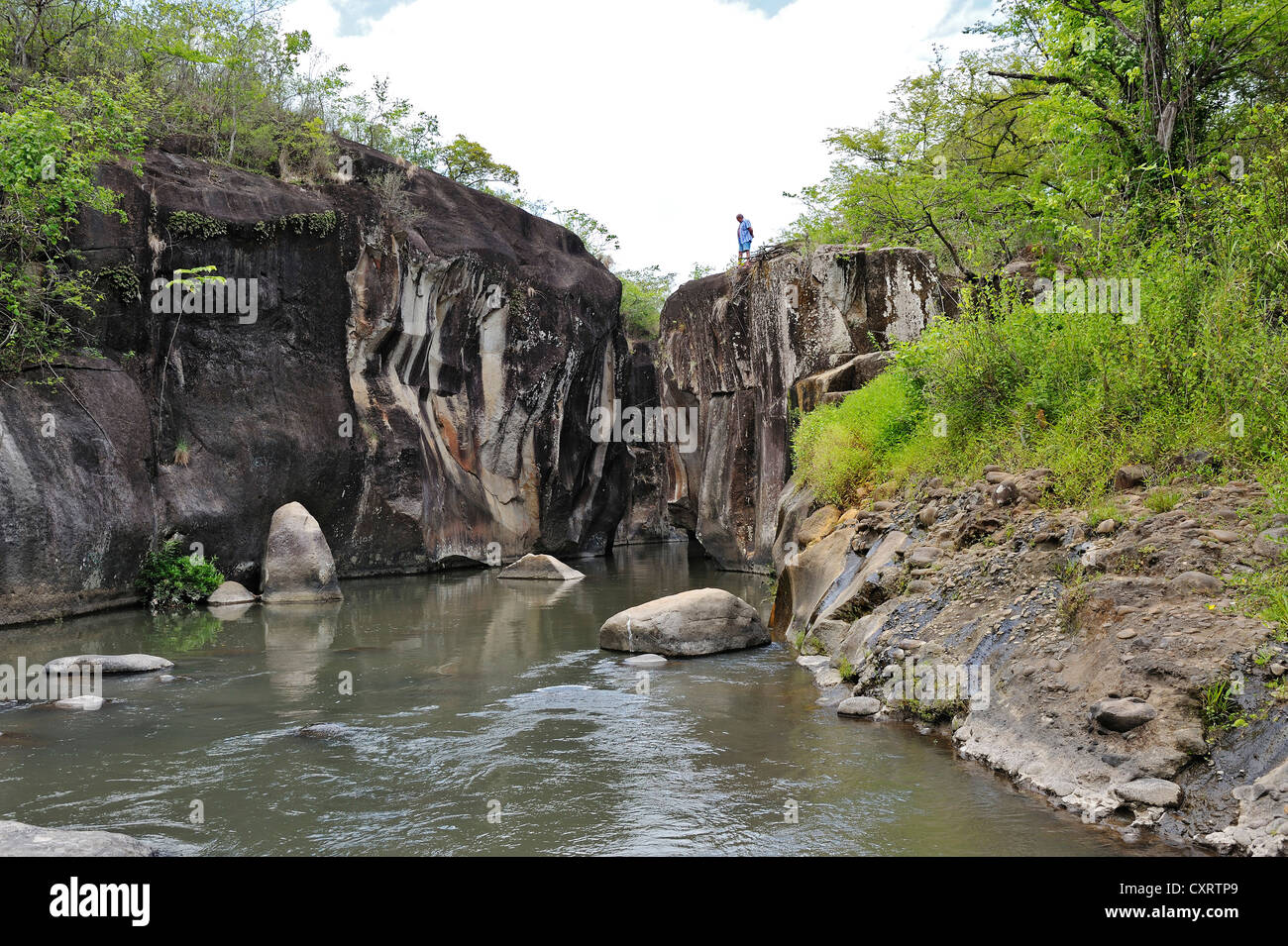 Tourists at a gorge with a river near Liberia, Guanacaste province, Costa Rica, Central America - Stock Image