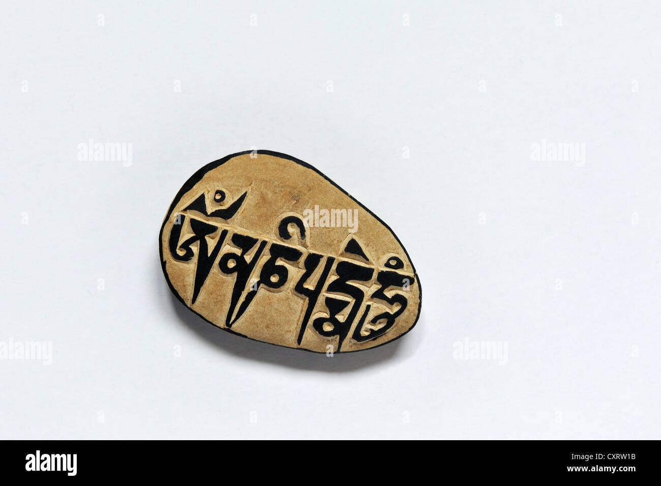 Ma ni rdo, Tibetan for mani stone, a souvenir from Tibet bearing the inscription, Om mani padme hum, which translates - Stock Image