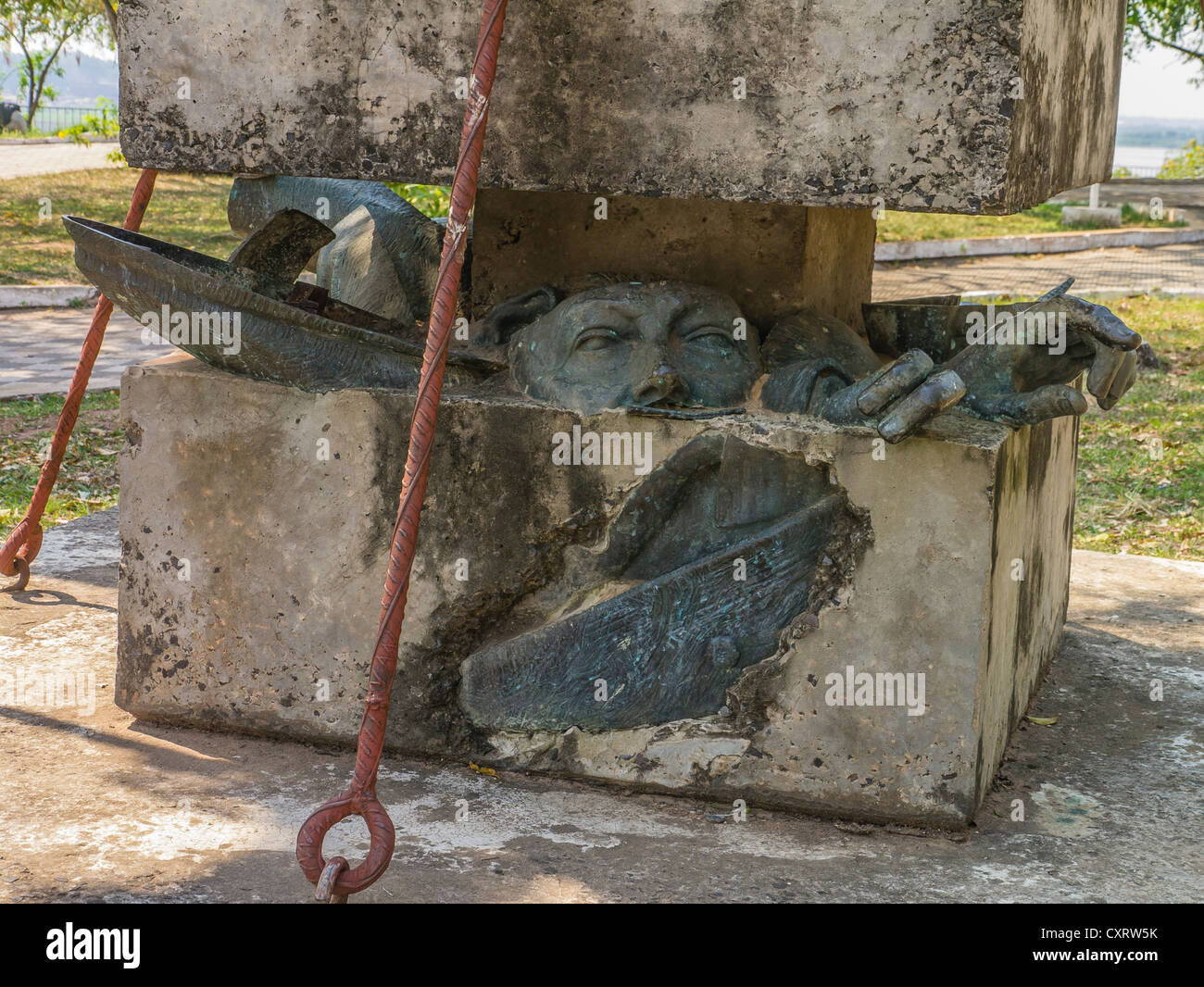 Reconstructed monument from parts of destroyed statue of Paraguayan dictator Alfredo Strössner with negative twist. Stock Photo