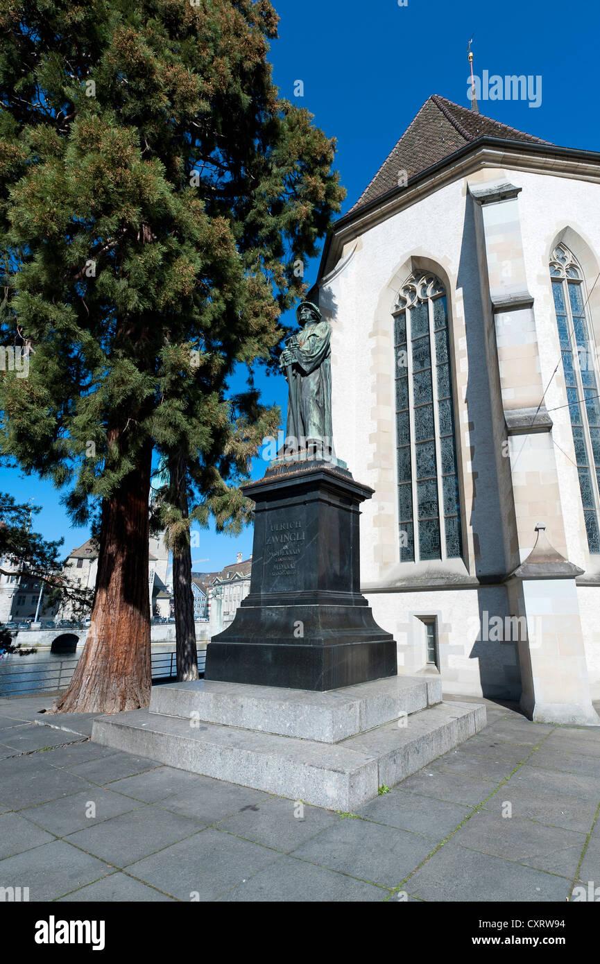 Statue of reformer Ulrich Zwingli in front of Wasserkirche church, Zurich, Switzerland, Europe - Stock Image