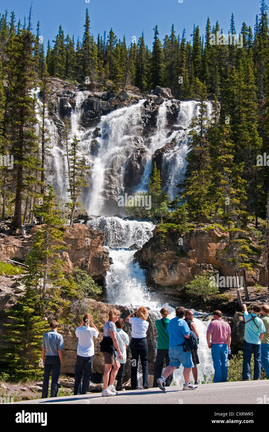 Tourists at Tangle Falls along Highway 93 in Jasper National Park, Alberta. - Stock Image