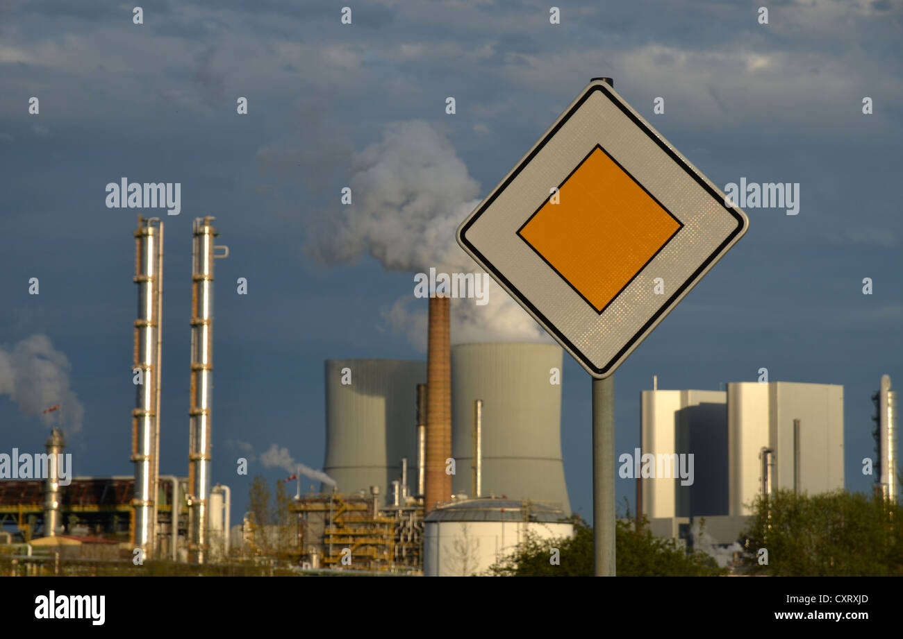 Main street sign, Boehlen chemical works and Lippendorf lignite power plant at back, Saxony, Germany, Europe - Stock Image