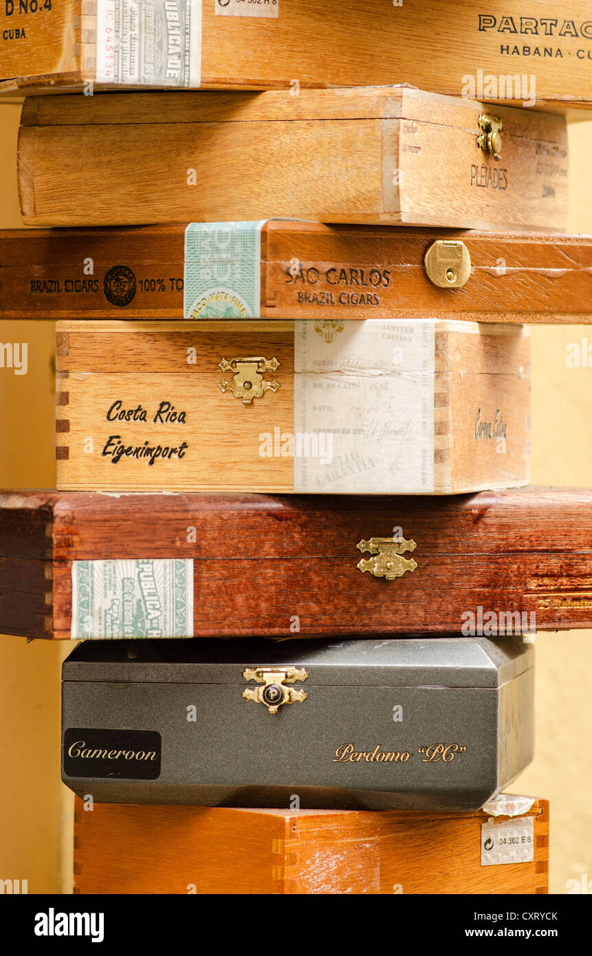 Cigar boxes, stacked - Stock Image