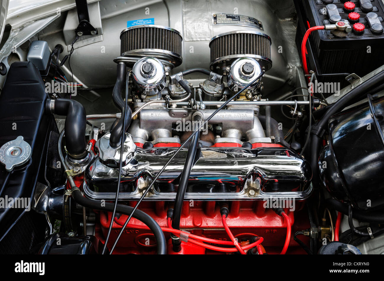 View of the engine compartment of a Volvo P1800S Pressed Steel, built in 1964, festival of classic cars 'Retro - Stock Image