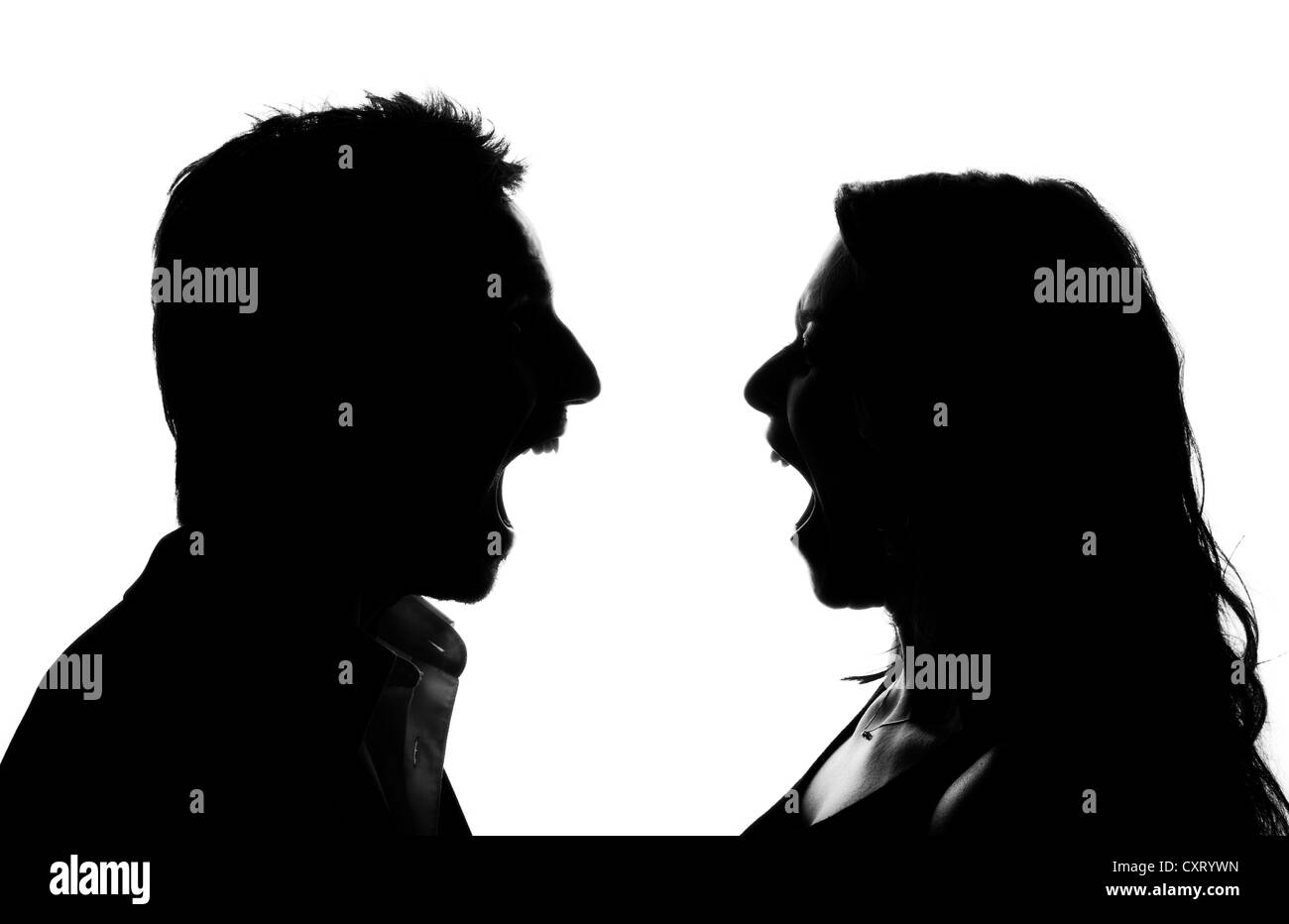 Silhouette, woman and man screaming at each other, argument - Stock Image
