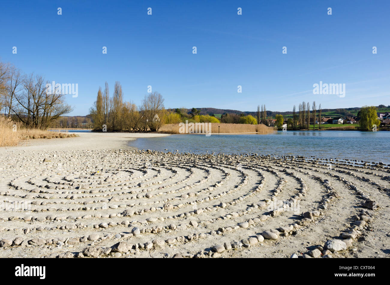 Stone labyrinth on Werd island, can be used for meditation, Werd island at the back, Canton of Schaffhausen, Switzerland, - Stock Image
