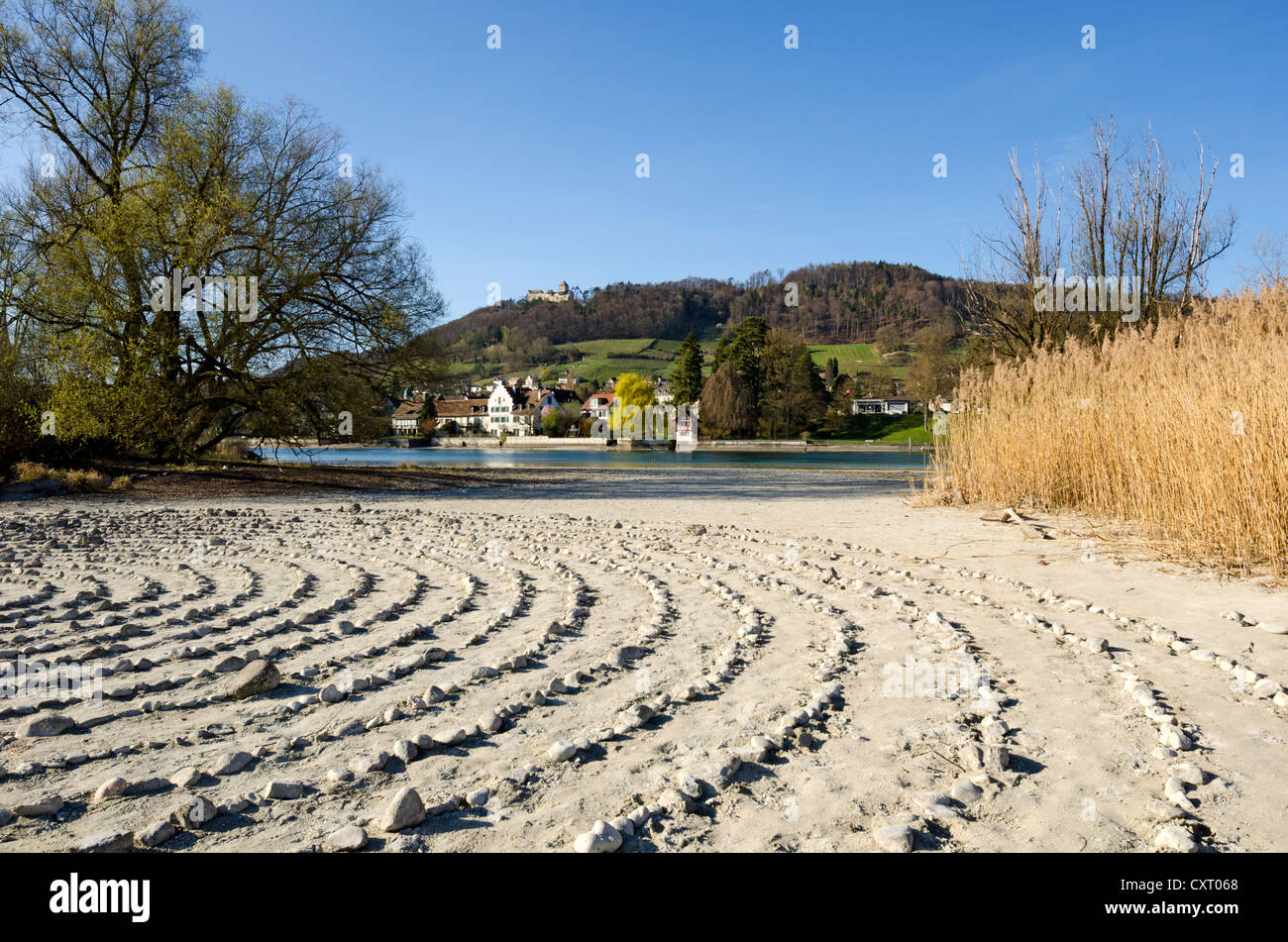 Stone labyrinth on Werd island, can be used for meditation, the historic district of Stein am Rhein and Hohenklingen - Stock Image