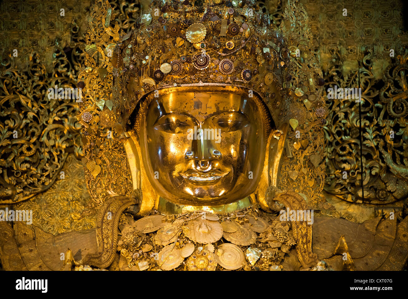 The most revered golden Mahamuni Buddha in Mandalay, Burma, Myanmar, Southeast Asia, Asia - Stock Image