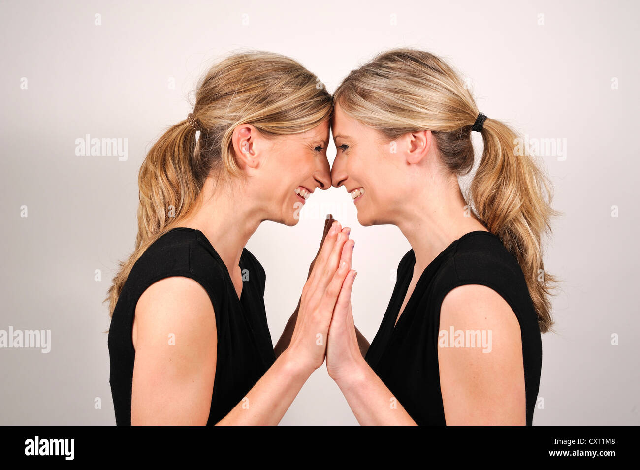 Twin Sisters Holding Others Hands Stock Photos Twin Sisters