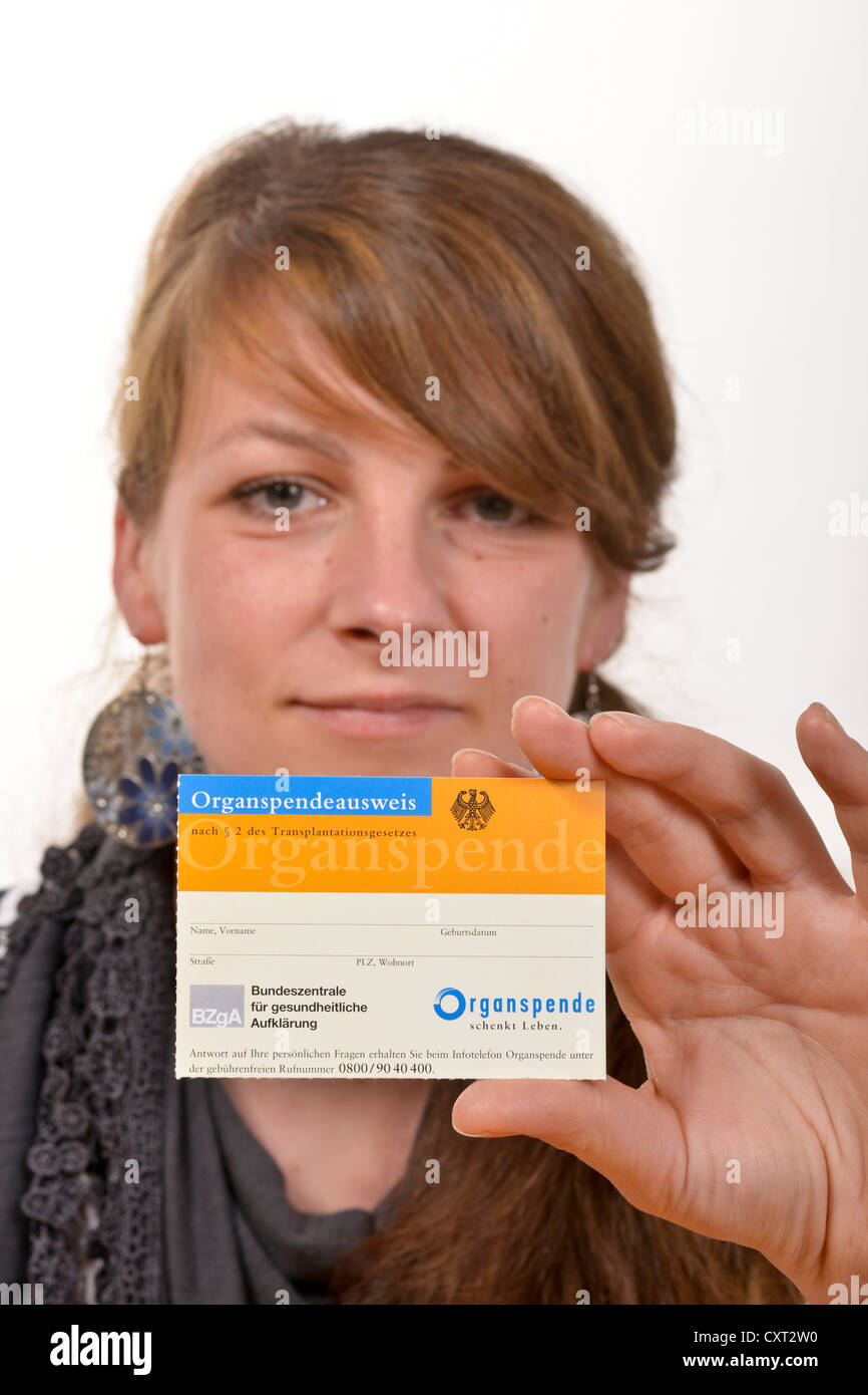 Young woman with a German organ donor card - Stock Image