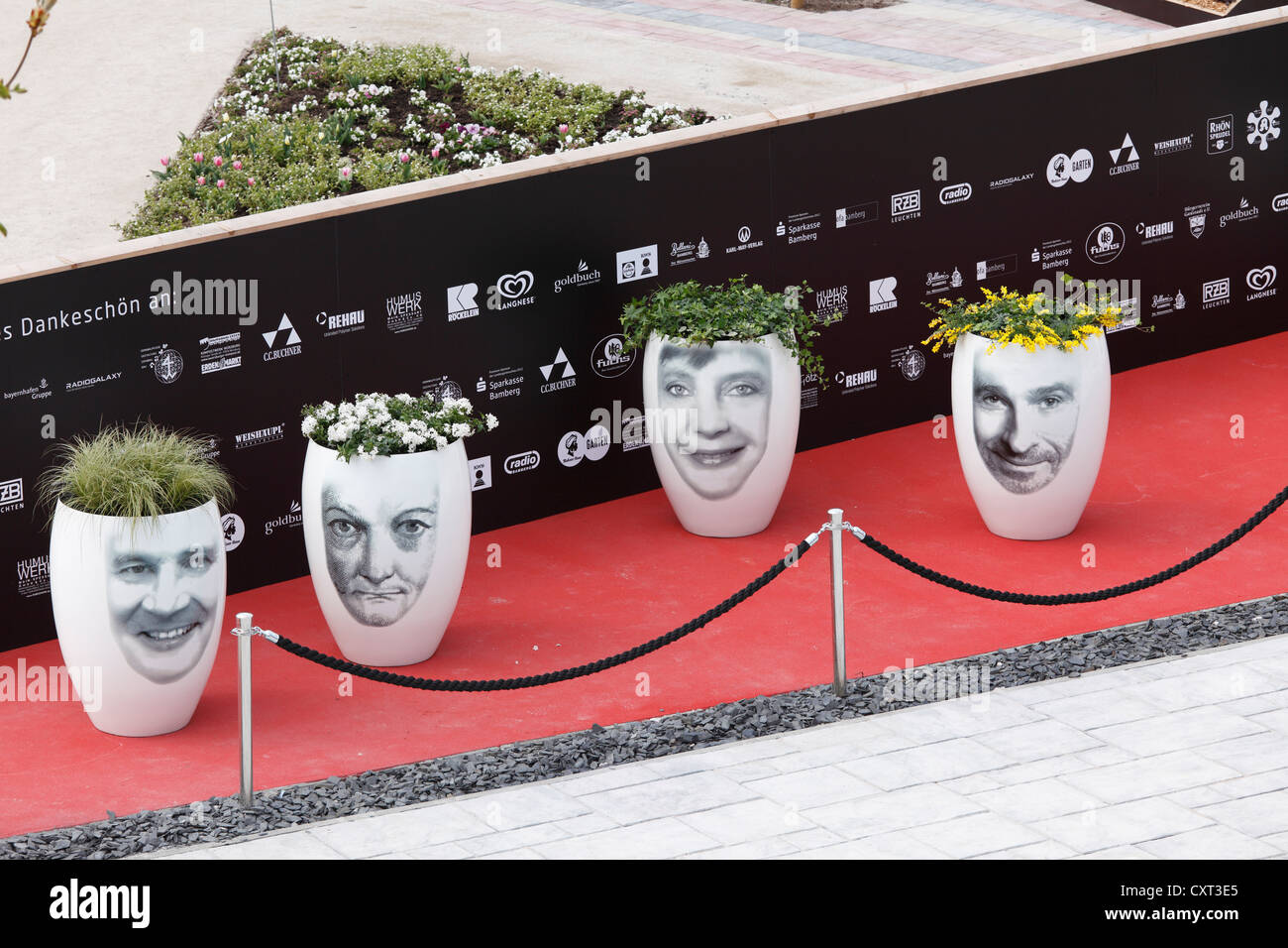 Flower pots with celebrity faces, 'VIP Garden', Bavarian horticultural show 2012 in Bamberg, Upper Franconia, - Stock Image