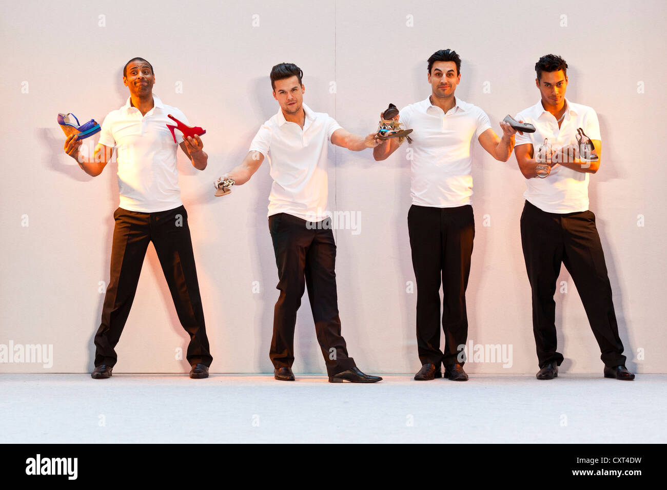 4 young men, models performing in the Spring and Summer Fashion Show 2012 in Pilatusmarkt in Kriens, Lucerne, Switzerland Stock Photo