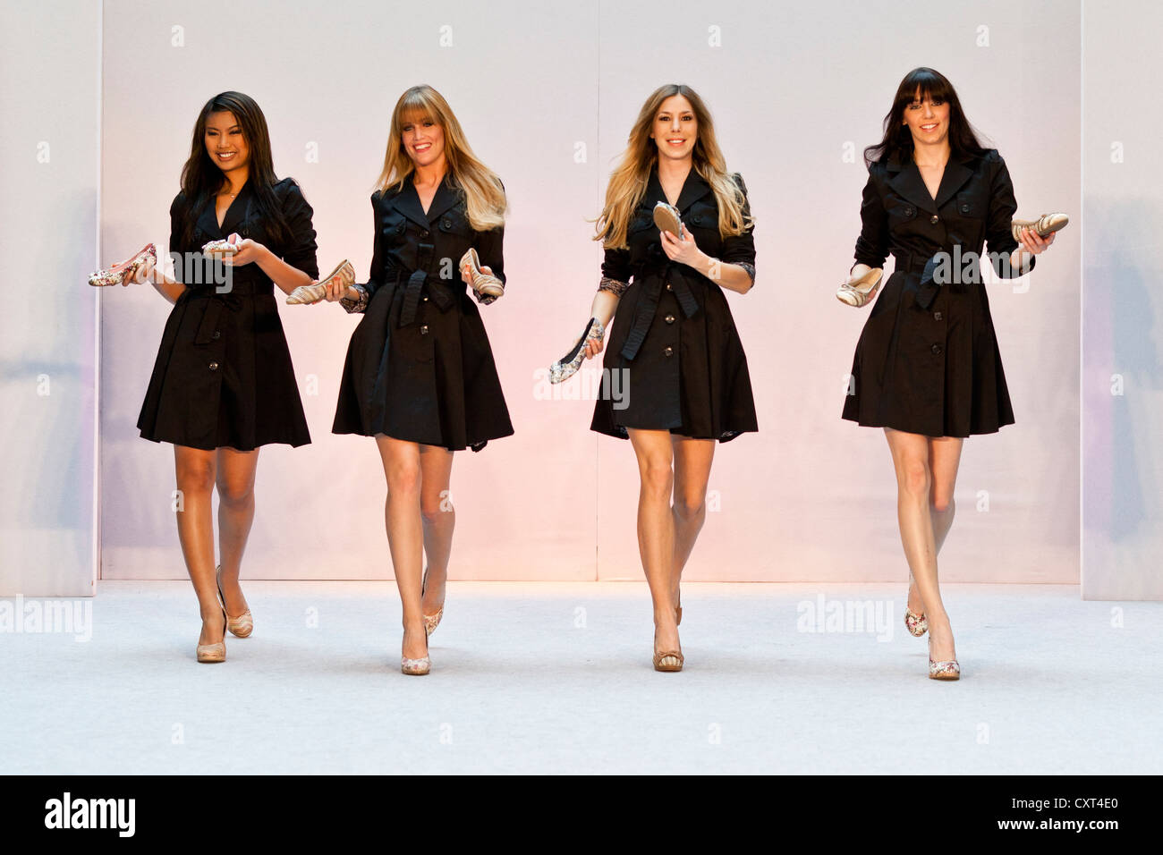4 young women, models performing in the Spring and Summer Fashion Show 2012 in Pilatusmarkt in Kriens, Lucerne, - Stock Image