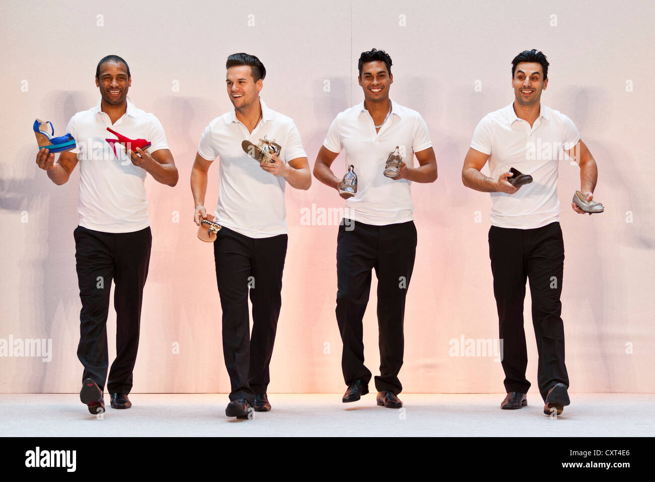4 young men, models performing in the Spring and Summer Fashion Show 2012 in Pilatusmarkt in Kriens, Lucerne, Switzerland - Stock Image