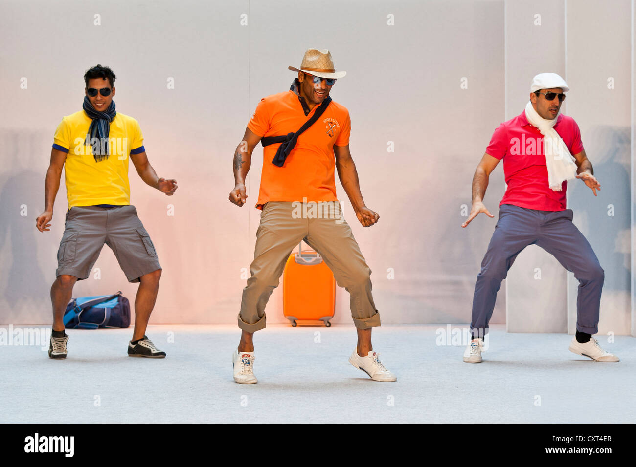 3 young men, models performing in the Spring and Summer Fashion Show 2012 in Pilatusmarkt in Kriens, Lucerne, Switzerland Stock Photo