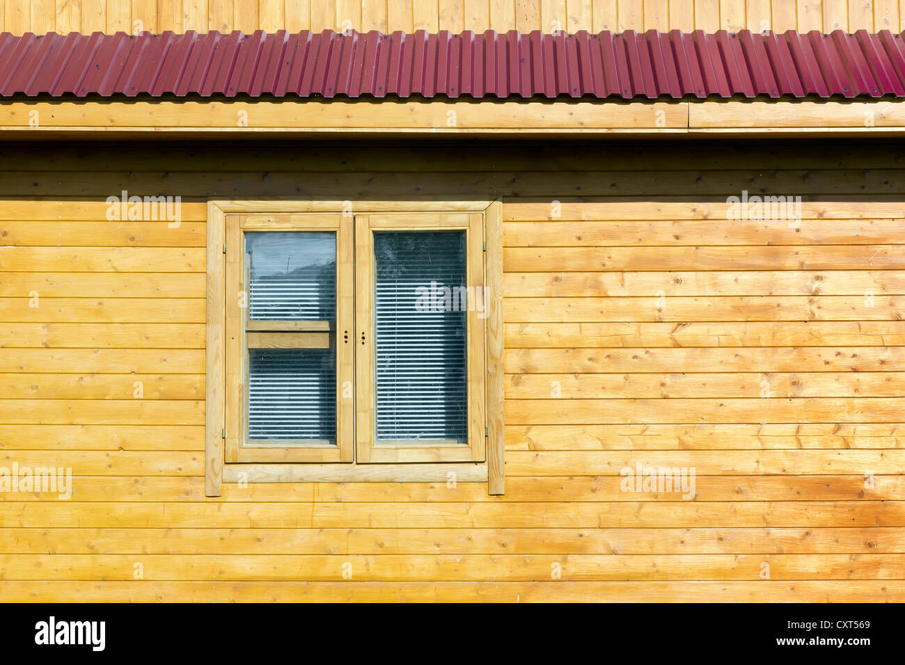 Rural rustic wooden house wall with widow is made by hand. The walls ...