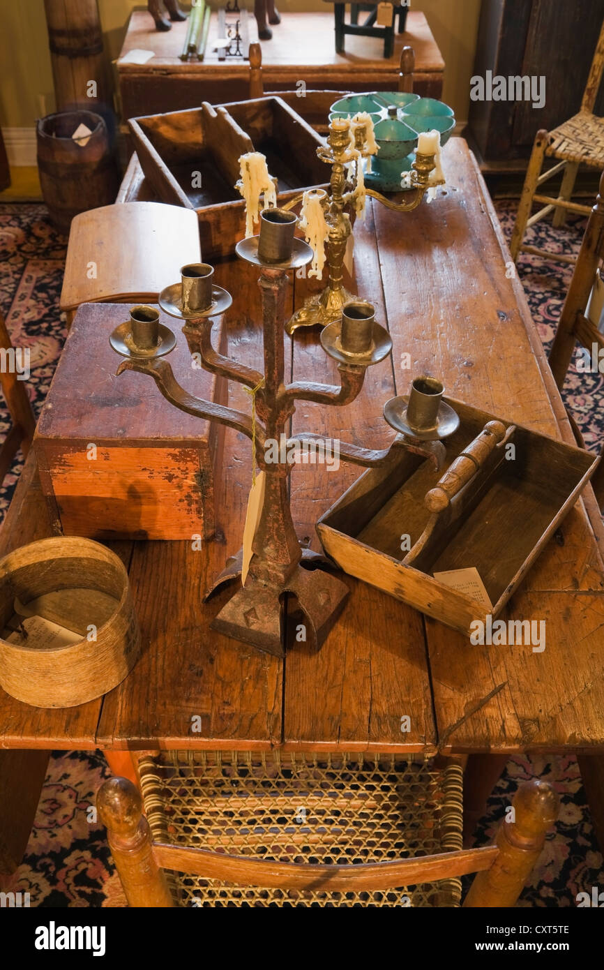Antique wooden dining table with decorative objects inside an old residential home and antique store, Lanaudiere, - Stock Image