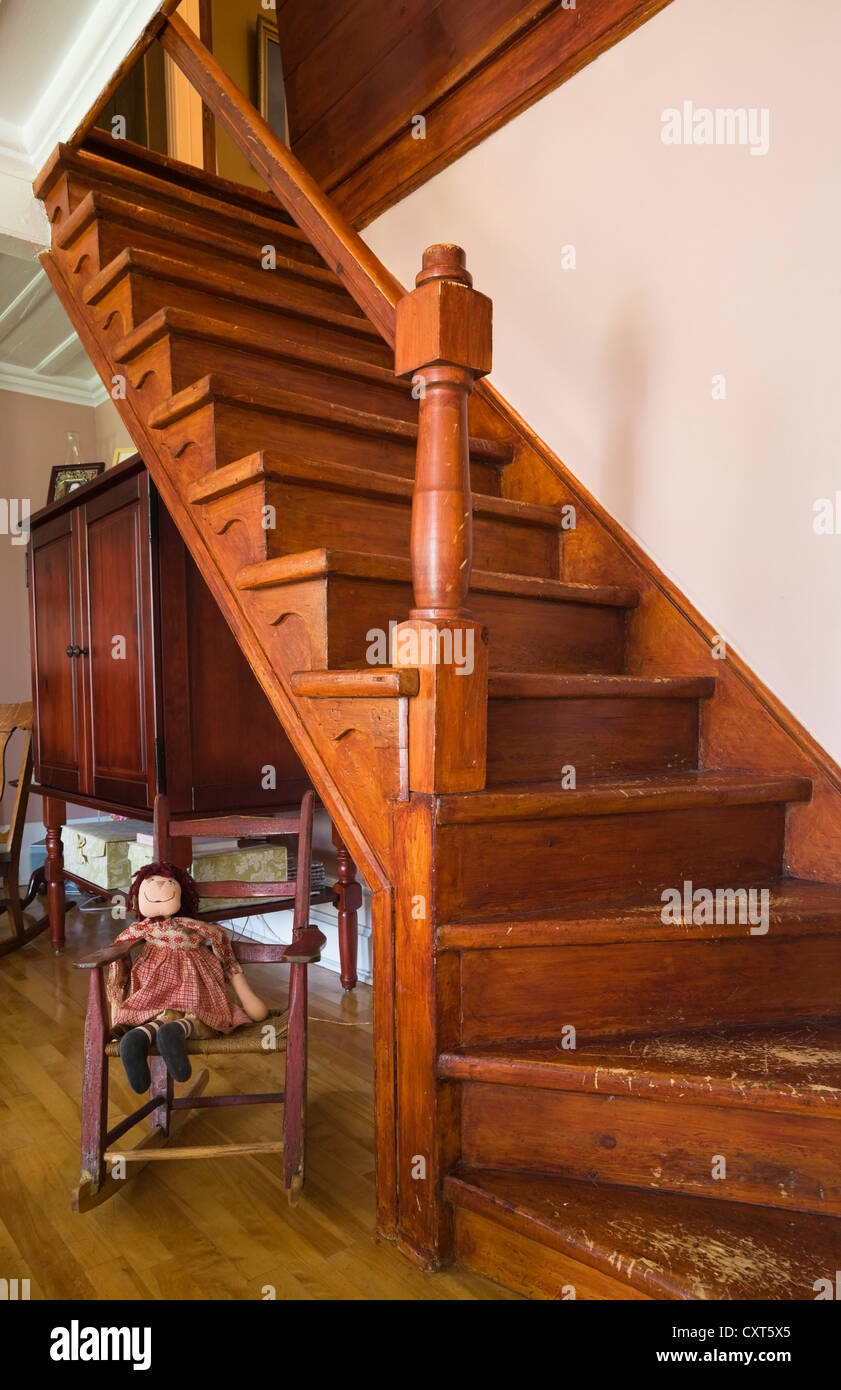 Old wooden staircase in the living room of an old Canadiana cottage-style quarry stone residential home, circa 1740, - Stock Image