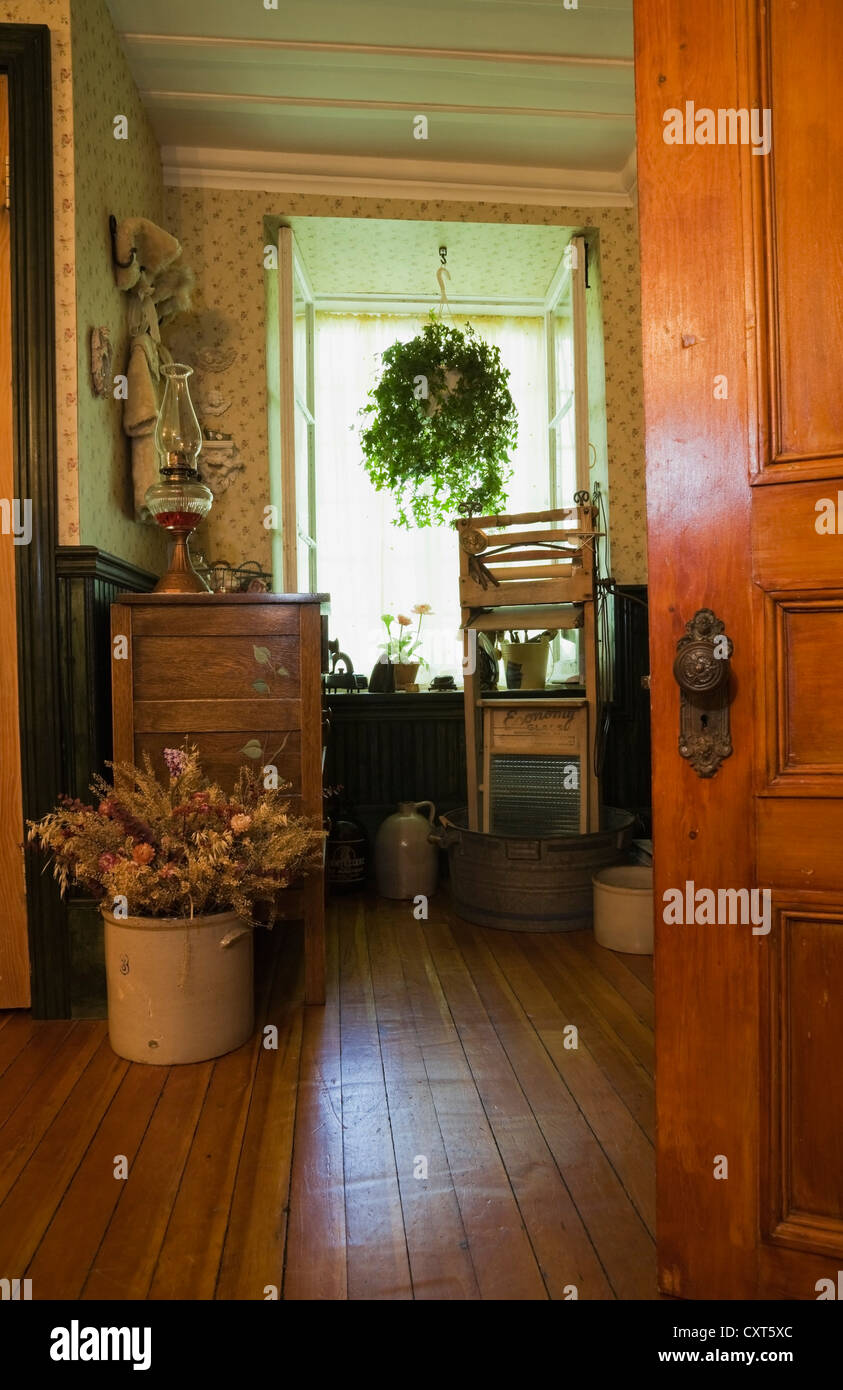 Partial view of a bathroom with antique furnishings in an old Canadiana cottage-style quarry stone residential home, - Stock Image