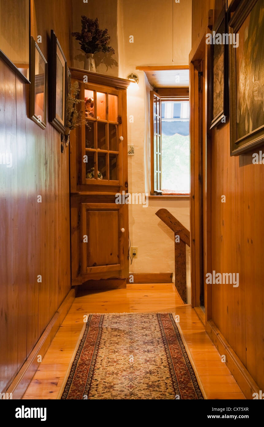 Pinewood hallway on the upstairs floor of an old Canadiana cottage-style residential fieldstone home, circa 1740, - Stock Image