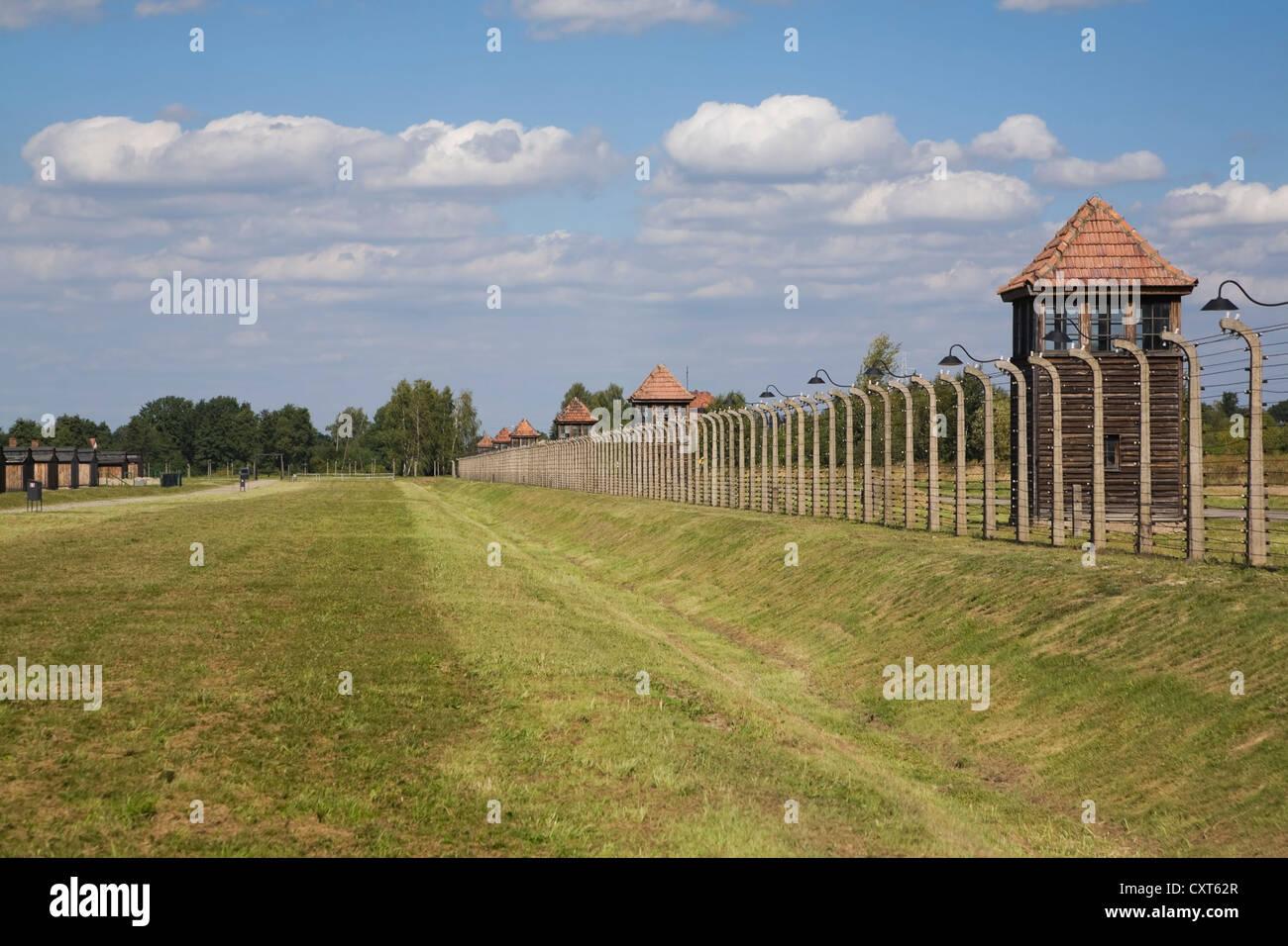 Barb wire electric fence surrounding the Auschwitz II-Birkenau former Nazi Concentration Camp, Auschwitz-Birkenau, - Stock Image