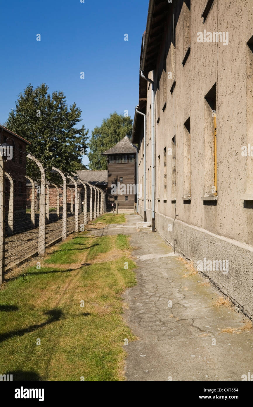 Barb wire fences and buildings inside the Auschwitz I former Nazi Concentration Camp, Auschwitz, Poland, Europe - Stock Image