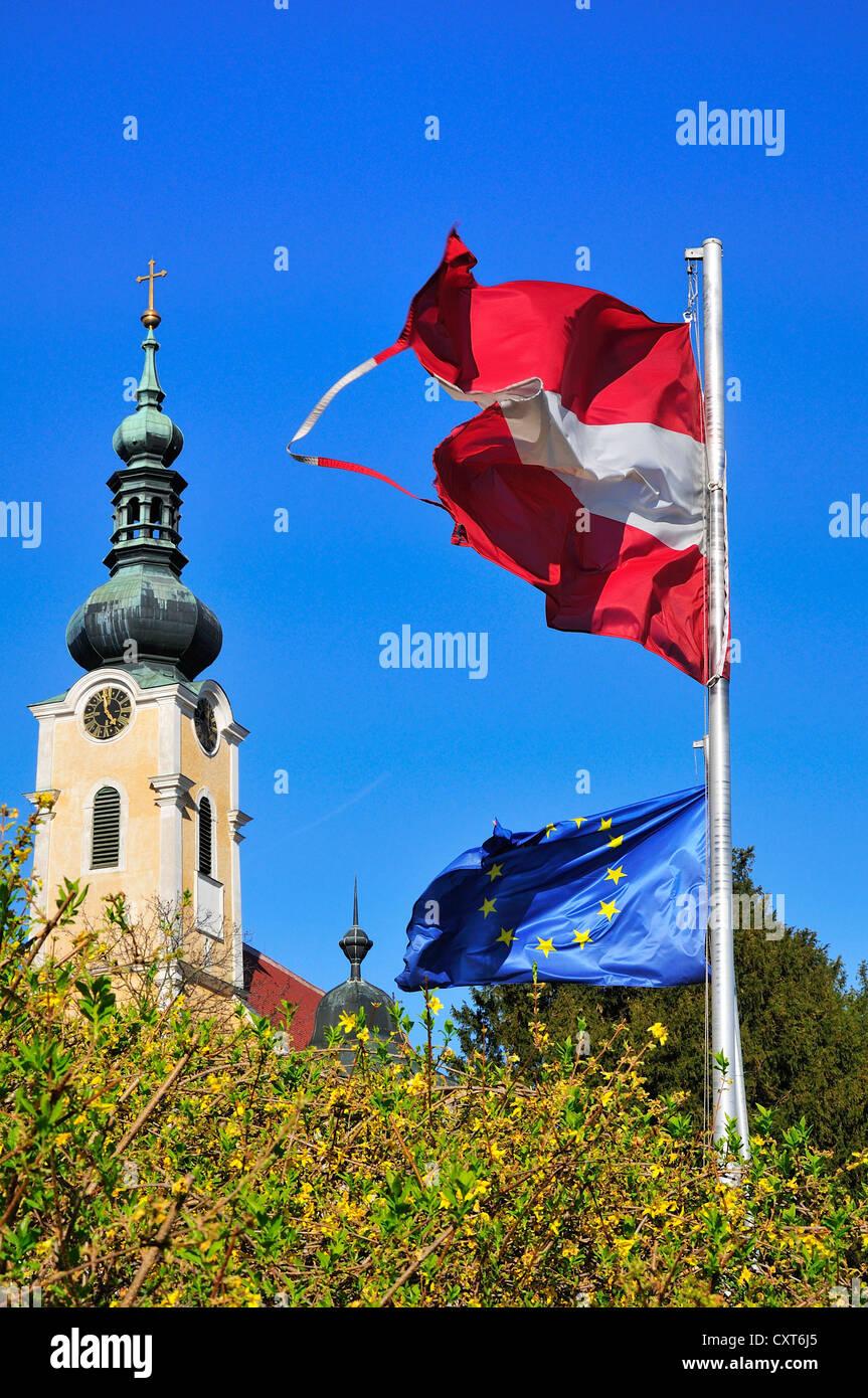 Spire of the church, Gobelsburg castle, an Austrian and an European flag, Langenlois, Lower Austria, Austria, Europe - Stock Image