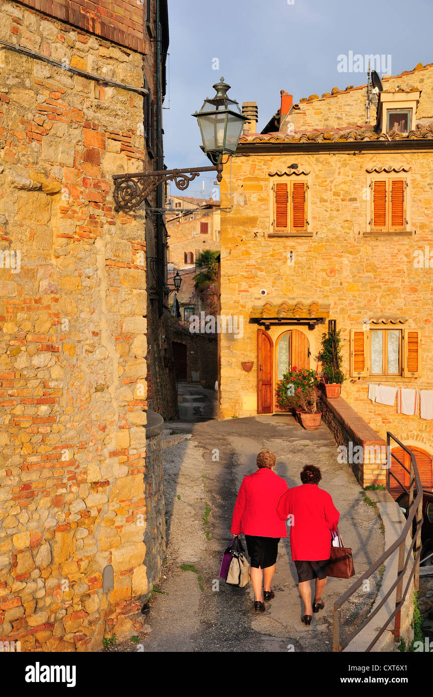 Old ladies in the historic district, Volterra, Tuscany, Italy, Europe - Stock Image