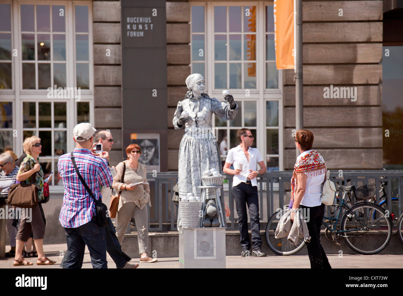 Street entertainer painted with silver colour in the city center, Free and Hanseatic City of Hamburg, Germany, Europe - Stock Image