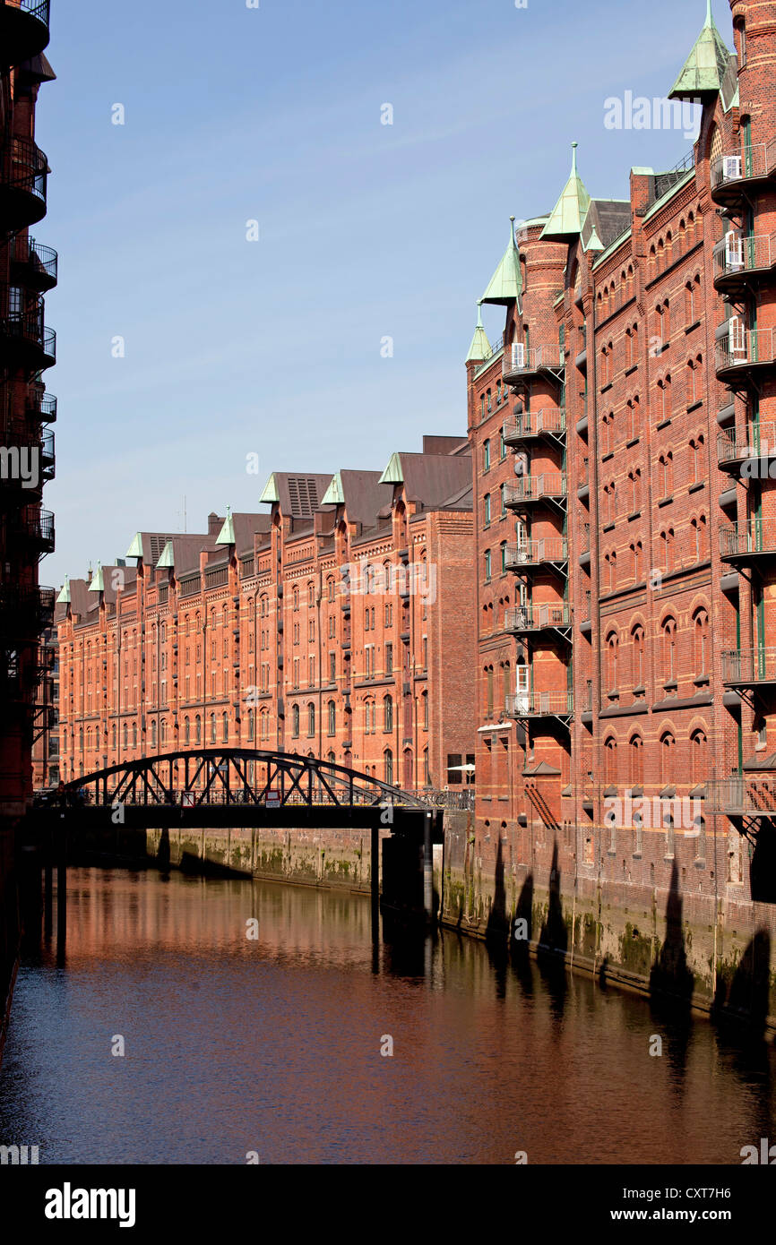 Warehouses and a channel in the Speicherstadt district, Free and Hanseatic City of Hamburg - Stock Image