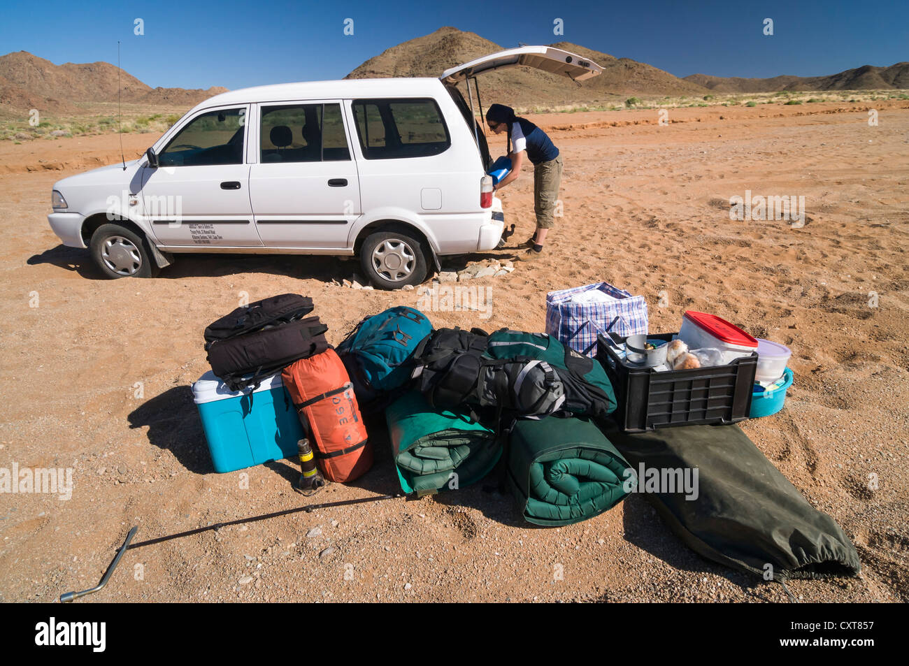 Baggage in front of a car which is stuck in the sand, Richtersveld National Park, Northern Cape, South Africa, Africa - Stock Image