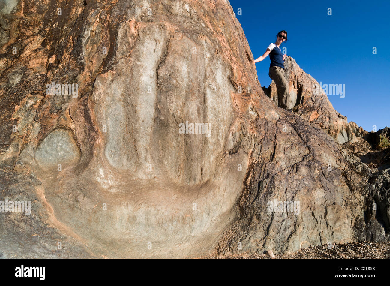 Woman on the rock formation called God's Hand, Richtersveld National Park, Northern Cape, South Africa, Africa - Stock Image