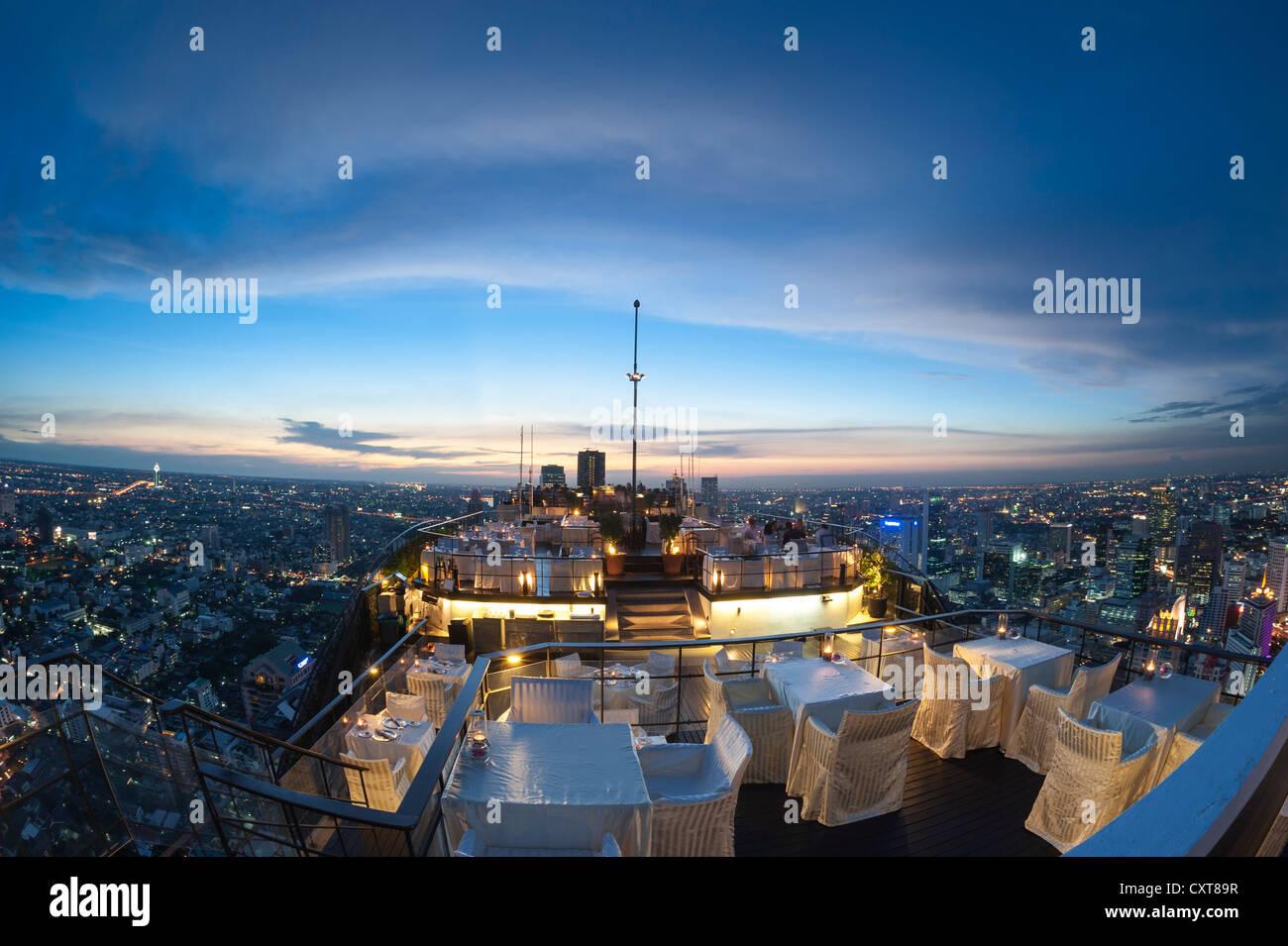 View of the city, Vertigo Bar and Restaurant, roof of the Banyan Tree Hotel, at dusk Bangkok, Thailand, Asia - Stock Image