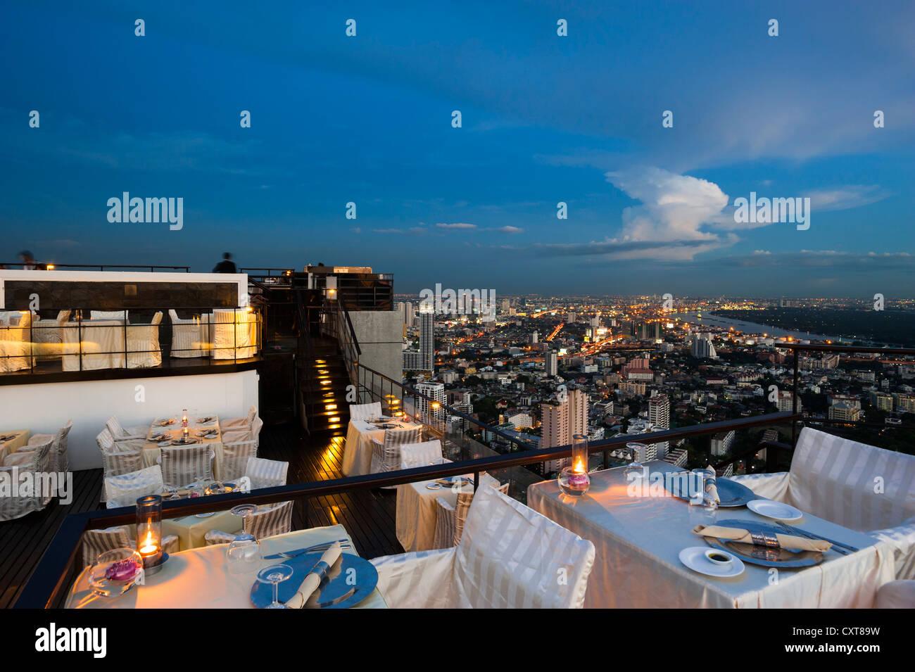 View of the city, Vertigo Bar and Restaurant, roof of the Banyan Tree Hotel, at dusk, Bangkok, Thailand, Asia - Stock Image