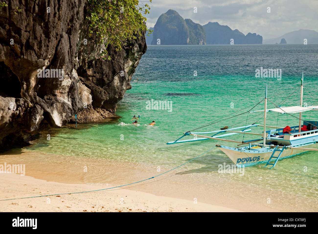 Snorkellers and a boat off Seven Commando Beach near El Nido, Palawan, Philippines, Asia - Stock Image