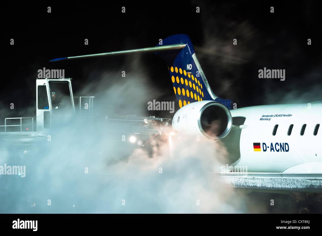 Lufthansa aircraft, Bombardier, being de-iced, Tegel Airport, Berlin - Stock Image