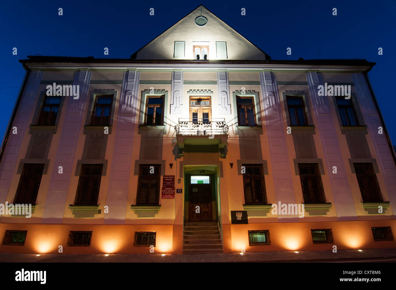 Building of the town council at night, Auschwitz, Oświęcim, Lesser Poland, Poland, Europe - Stock Image