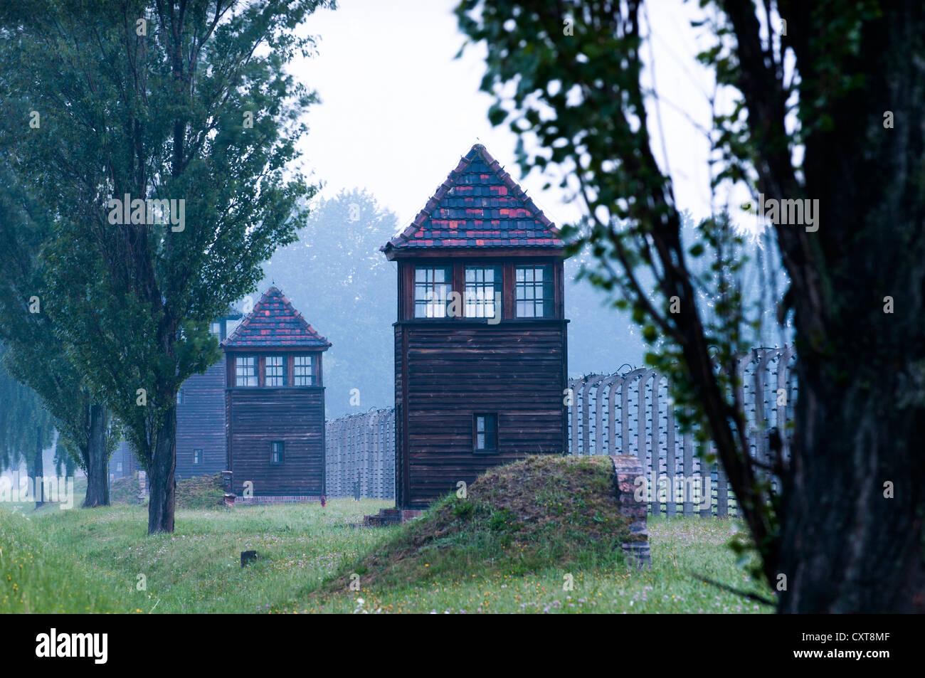 Watchtower and barbed wire fence, Auschwitz-Birkenau concentration camp, Auschwitz, Lesser Poland, Poland, Europe - Stock Image