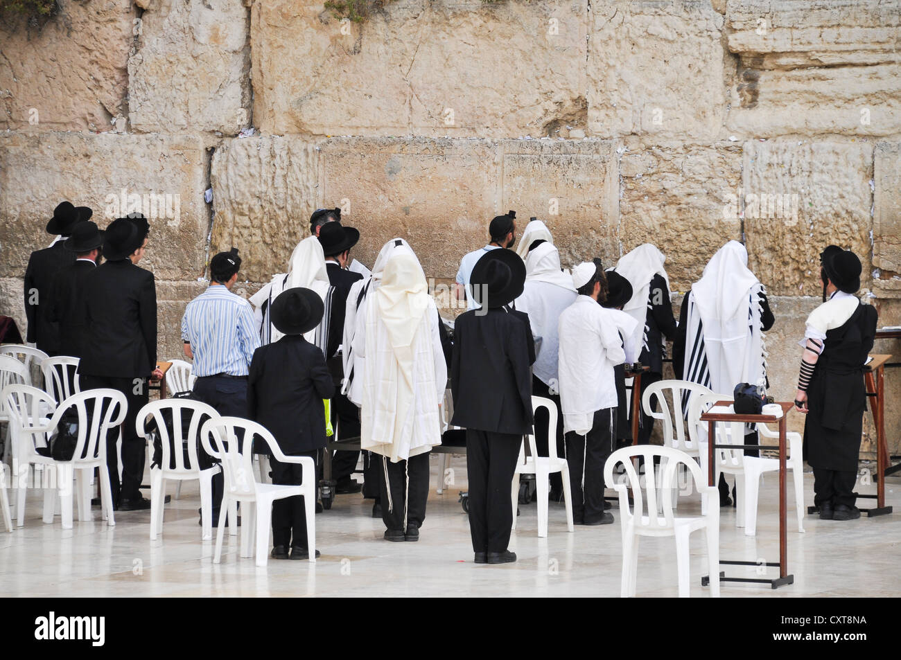 Jewish men praying, worshipers at the Wailing Wall, Jerusalem, Israel, Middle East, Southwest Asia - Stock Image
