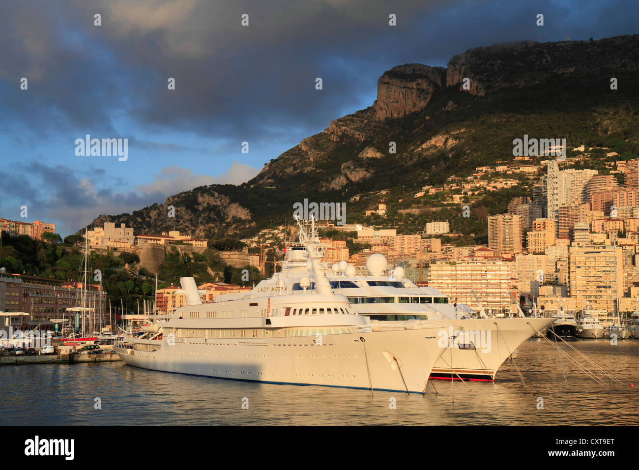 Port Hercule in the early morning with the cruisers Atlantis II and Lady Moura, Principality of Monaco, French Riviera - Stock Image