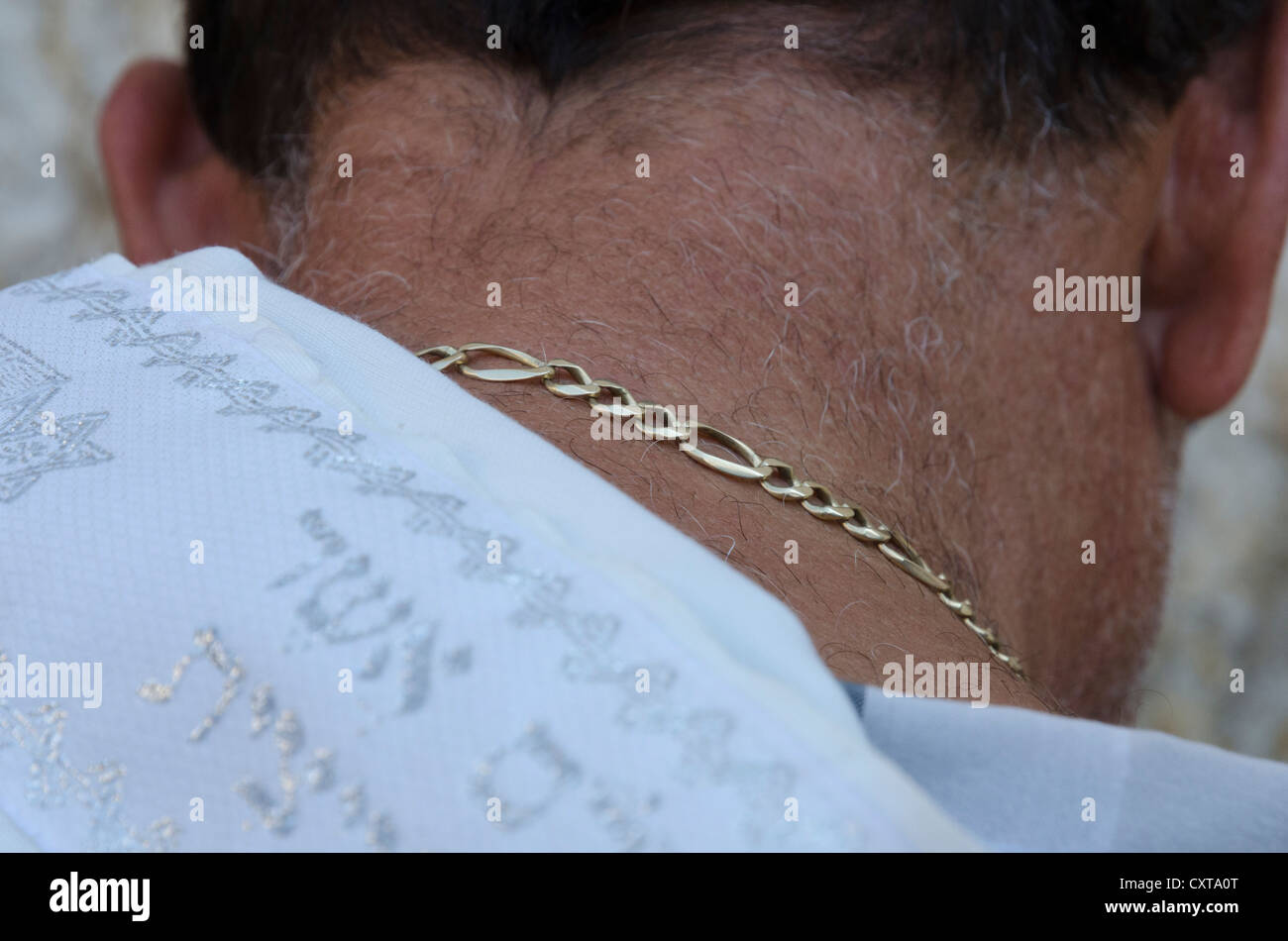 close up of a Jew with prayer shawl and chain praying at the Western Wall. Jerusalem Old City. Israel. - Stock Image