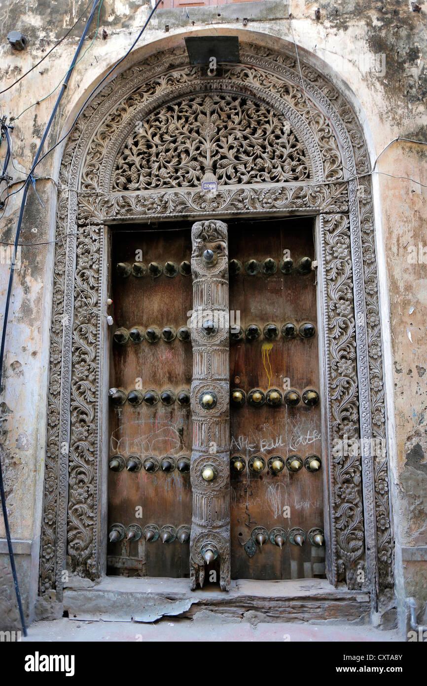 Old ornate arabic door in Stone Town Zanzibar Tanzania - Stock Image