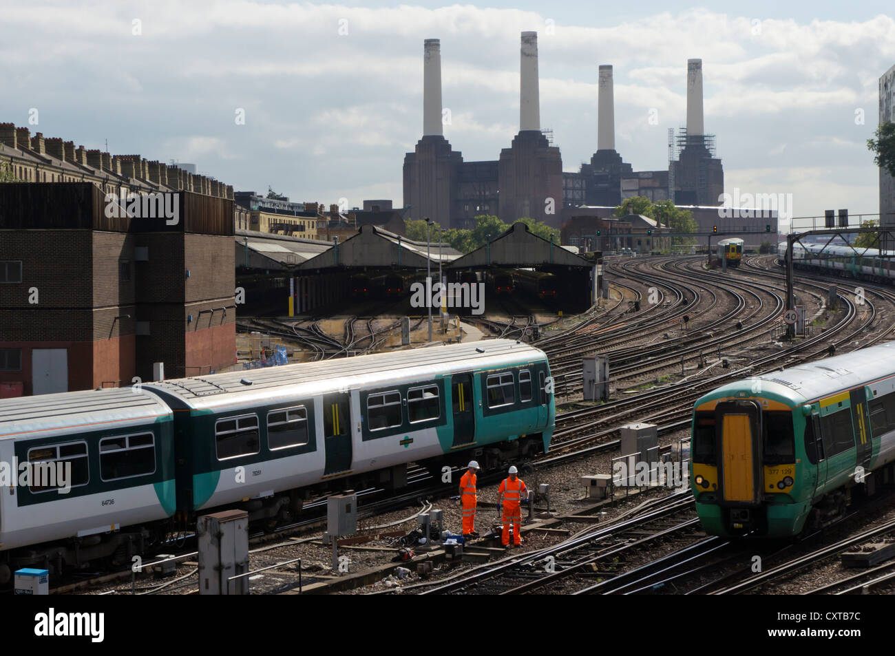 Trains approaching London Victoria station from South London. - Stock Image