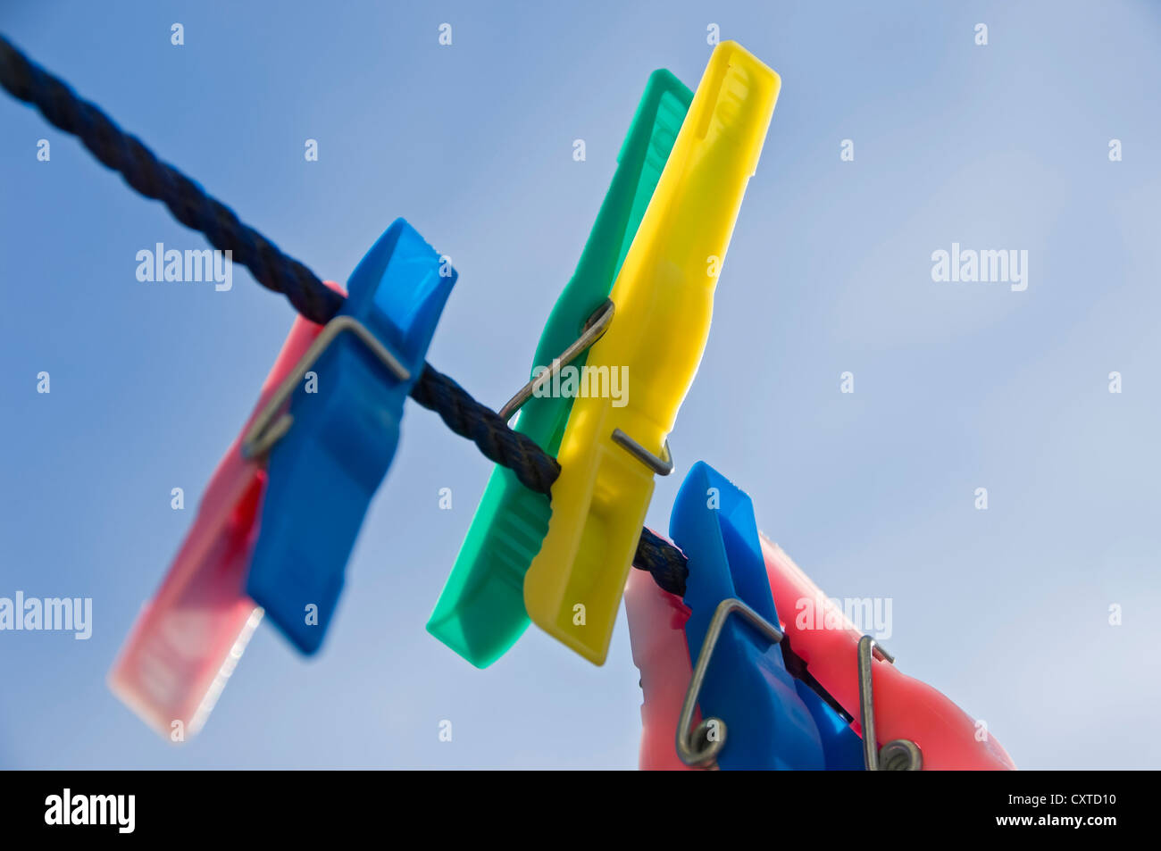 Close up of plastic clothes pegs peg on washing line England UK United Kingdom GB Great Britain Stock Photo